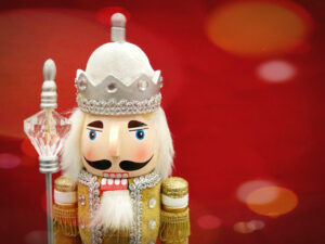 a gold nutcracker on a red background
